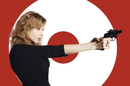Businesswoman aiming a pistol photo