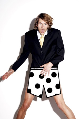 Businessman in boxer shorts showing shocked expression photo