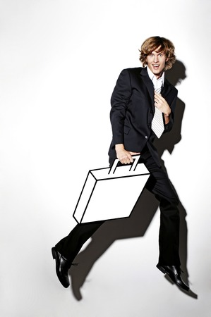 Businessman carrying briefcase photo
