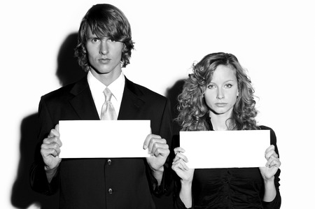 blank papers: Businessman and businesswoman holding blank papers