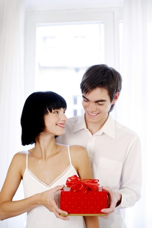 Man giving his wife a surprise gift Stock Photo - 26452260