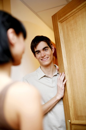 Man opening the door for his wife photo