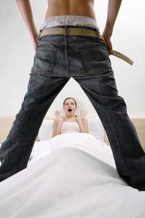 Man taking off his pants shocking his wife