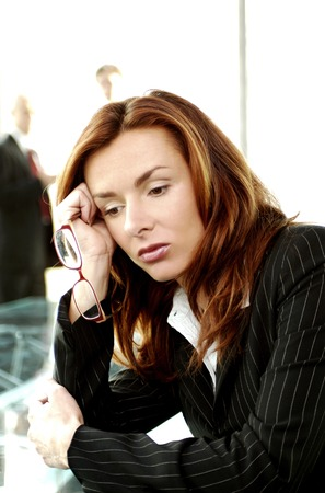 Businesswoman looking depressed Stock Photo