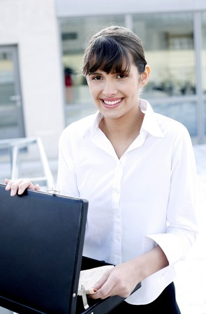 opened bag: Businesswoman taking out documents from the briefcase
