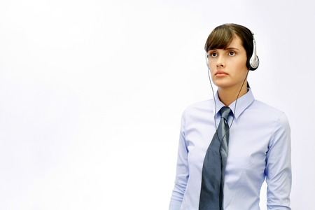 Businesswoman listening to music on the headphones photo