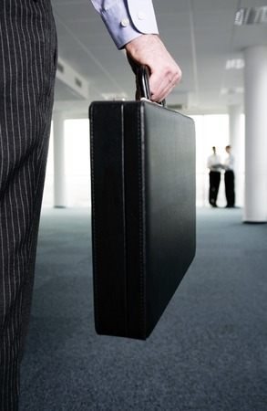 desirous: Businessman carrying a briefcase Stock Photo
