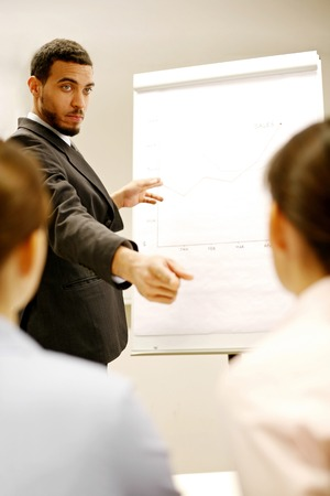 desirous: Businessman giving presentation in the conference room Stock Photo