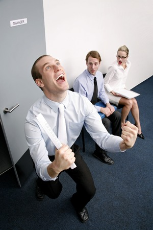 desirous: An overjoyed businessman after passing a job interview