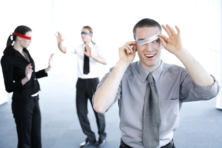 constraint: Businessman cheating during a blindfolding game