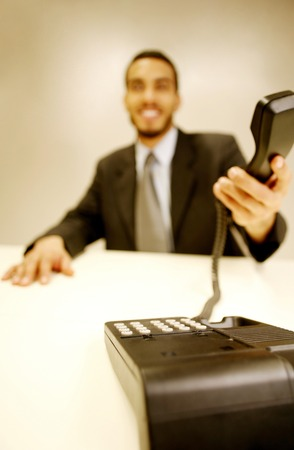 Businessman picking up a phone call photo