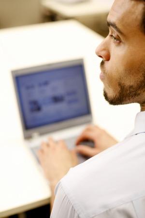 businessman working at his computer: Businessman using laptop