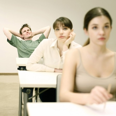 paying attention: Man not paying attention in class
