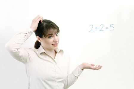 Woman having problem solving a simple equation photo