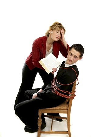 disciplinary action: Teacher forcing her student to study Stock Photo