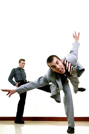 Businessman being kicked out by his employer photo