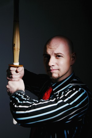 sword act: Businessman practicing martial art Stock Photo