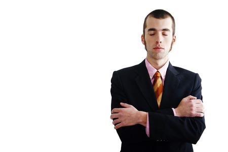 eyes closing: El hombre de negocios cerrando los ojos mientras dobla los brazos Foto de archivo