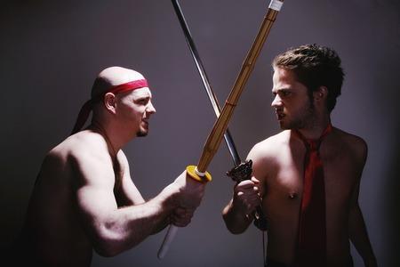 sword act: Businessmen practicing martial art