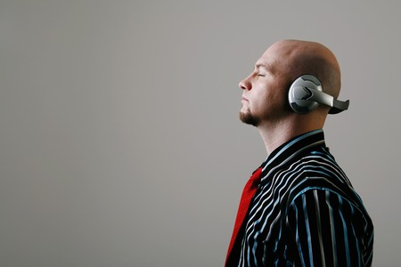 Businessman listening to music photo