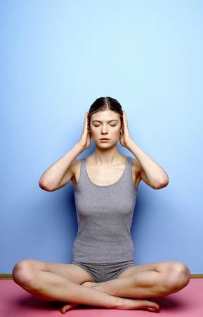 Woman practicing yoga Stock Photo - 26196175
