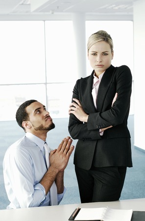 Businessman begging his superior photo
