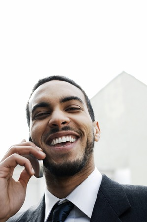 Businessman laughing while talking on the cell phone photo