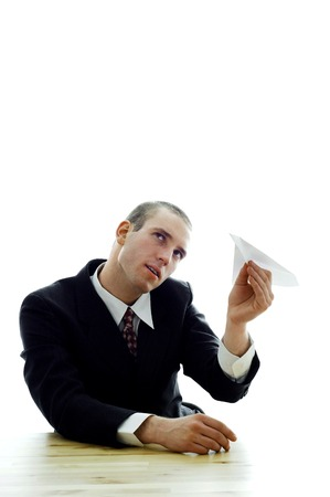 Businessman playing with a paper plane photo