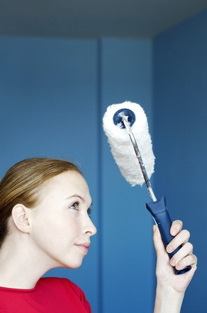 Woman holding a paint roller photo