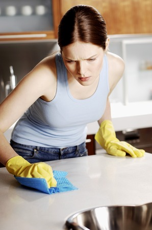 meticulous: Woman wiping the table