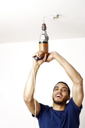 Man drilling the ceiling photo