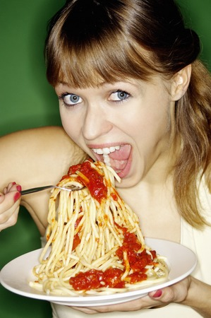 Woman eating spaghetti photo