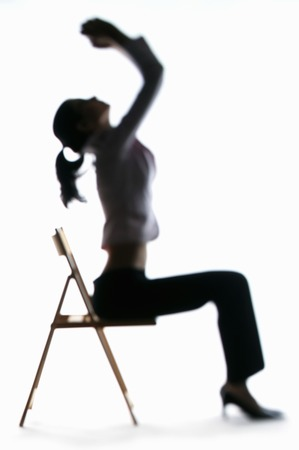 Silhouette of businesswoman sitting on the chair photo