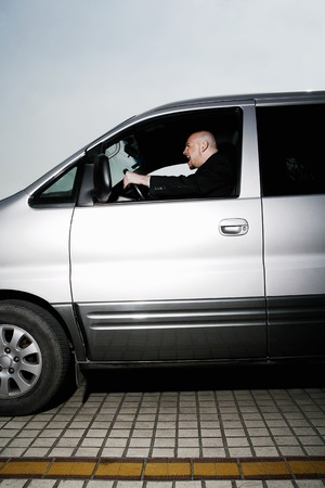 Businessman driving aggressively photo