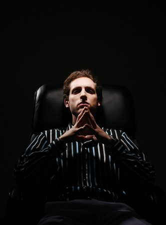 Businessman sitting on the chair thinking photo