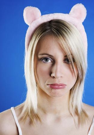 Woman in cute bear hair band sulking
