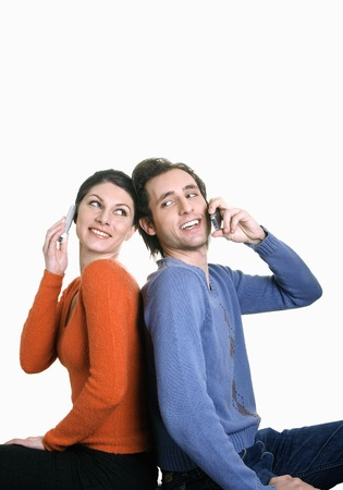 Man and woman talking on their cell phones photo