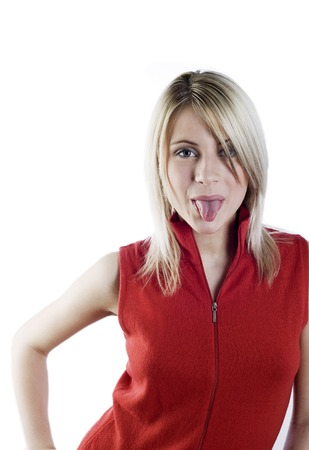 sense: Woman sticking out her tongue Stock Photo
