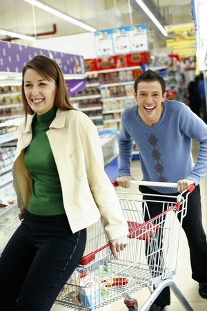 Couple having fun shopping in the supermarket photo