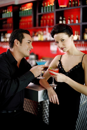 Couple drinking at bar counter photo