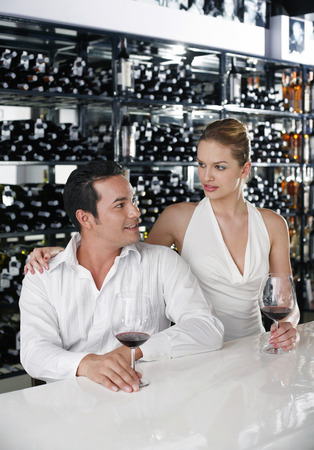 Man and woman sitting at bar counter talking photo