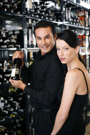 Couple choosing wine in the wine cellar photo