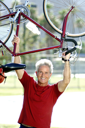 Man lifting up bicycle photo