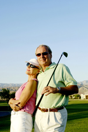 Couple posing in the golf course photo