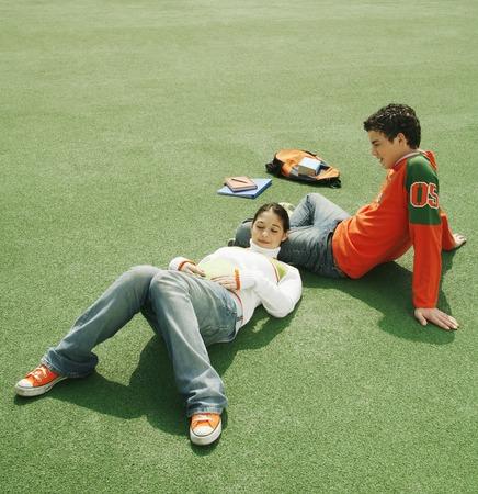 Girl sleeping on her boyfriends lap photo