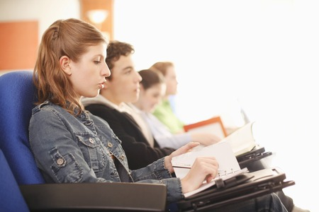 Students paying attention in lecture hall photo