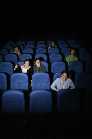 watching movie: Teenagers watching movie in cinema Stock Photo
