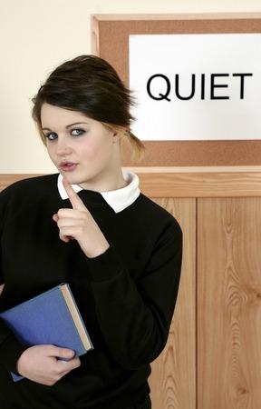 hushing: Girl showing hushing sign Stock Photo