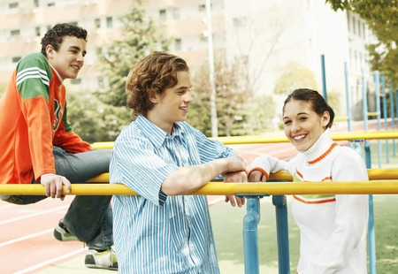 Boys and girl hanging out together after class