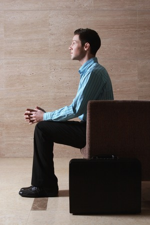Businessman sitting on the couch Imagens